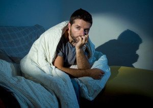 WORRIED MAN IN BED